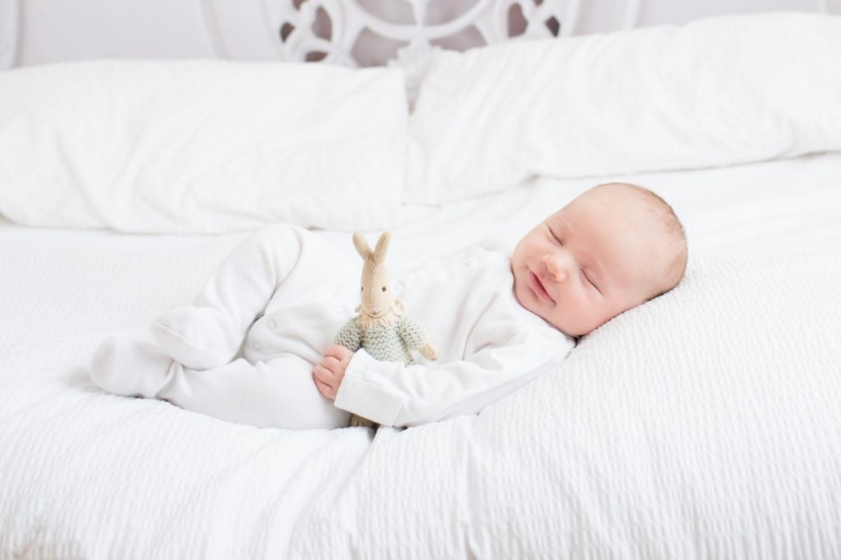 Baby on white bed